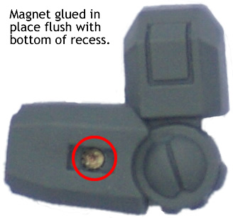 Magnet glued in place flush with bottom of recess.