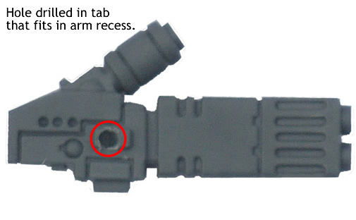 Hole drilled in tab that fits in arm recess.